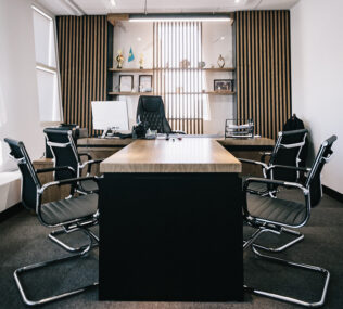 Office with chairs around a desk